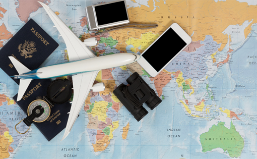 Image showing a plane, a map, and various other travel-related items